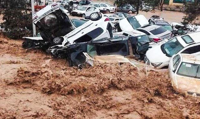 Iranian Youths Symbolic Move to Protest Iran Regime's Failure to Help Flood Victims